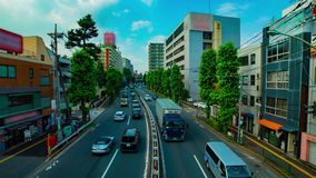 Timelapse w centrum ulica przy Kanpachi aleją w Tokio strzału dziennym szerokim panning zdjęcie wideo