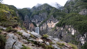 Timelapse - Waterfall in a tree-covered mountains stock video