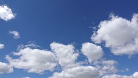 Timelapse of white clouds, 4k. Beautiful cloud are moving in sunshine in the blue sky stock video
