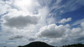 Timelapse of white clouds running over blue sky stock video footage