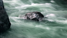 Timelapse - Whitewater flowing around the rock stock video footage