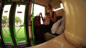 Timelapse of woman with mobile in the bus. Timelapse wide angle shot of a woman passing the time with surfing the net on smart phone during the bus ride stock video footage