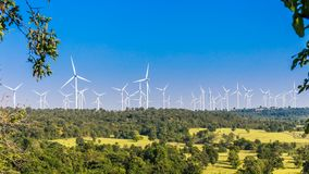 Timelapse of Wind turbine farm in beautiful nature with blue sky blackground, generating electricity stock video footage