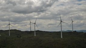 Timelapse of a wind turbine farm on top of a hill in Northeastern Portugal, renewable energy concept.  stock footage