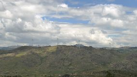 Timelapse of a wind turbine farm on top of a hill in Northeastern Portugal, renewable energy concept.  stock video