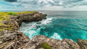Timelapse Wonderful waves in turquoise ocean with the cloudy sky and surrounding by the cliffs in Nusa Ceningan island. 4K Timelapse in Nusa Lembongan and Nusa stock video