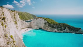 Timelapse of the world famous Navagio beach, Zakynthos, Greece. Turquoise sea water rolled to white sand beach with stock footage