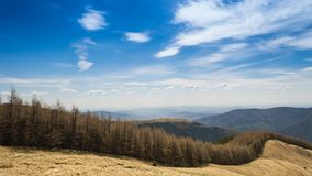 Timelapsed scenery with mountain forest, cloudy sky and valley of cities stock video