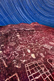 Timeless. Sky Rock in the Eastern Sierras is a five thousand year old petroglyph and one of two on the planet that faces up towards the sky.  Here, the passing Stock Photos