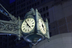 Timeless antique. Antique clock mounted on side of building Royalty Free Stock Images