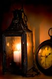 Timeless Romance. Antique clock and lantern Royalty Free Stock Photos
