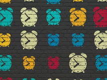 Timeline concept: Alarm Clock icons on wall Royalty Free Stock Photography