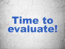 Timeline concept: Time to Evaluate! on wall background. Timeline concept: Blue Time to Evaluate! on textured concrete wall background Stock Images
