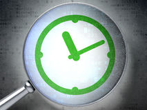 Timeline concept:  Clock with optical glass on digital backgroun Royalty Free Stock Photography