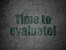 Timeline concept: Time to Evaluate! on grunge wall background. Timeline concept: Green Time to Evaluate! on grunge textured concrete wall background Stock Photography