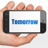 Timeline concept: Hand Holding Smartphone with Tomorrow on display. Timeline concept: Hand Holding Smartphone with blue text Tomorrow on display, 3D rendering royalty free stock photography