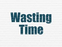 Timeline concept: Wasting Time on wall background. Timeline concept: Painted blue text Wasting Time on White Brick wall background Royalty Free Stock Image