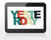 Timeline concept: Tablet Pc Computer with Yesterday on  display Stock Photo