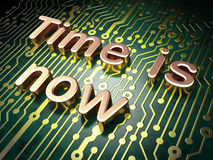 Timeline concept: Time is Now on circuit board Royalty Free Stock Photos