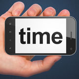 Timeline concept: Time on smartphone. Timeline concept: hand holding smartphone with word Time on display. Mobile smart phone on Blue background, 3d render stock photography