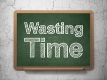Timeline concept: Wasting Time on chalkboard background. Timeline concept: text Wasting Time on Green chalkboard on grunge wall background, 3D rendering Royalty Free Stock Photo