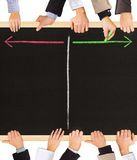 Timeline. Photo of business hands holding blackboard and writing timeline arrows royalty free stock photos
