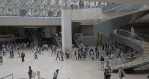 Timelpase of people traffic in the Louvre lobby stock video