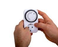 Timer Adjusting Man. On Electrical Socket Royalty Free Stock Image