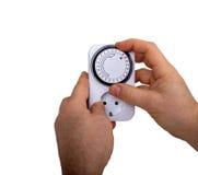 Timer Adjusting Man. On Electrical Socket Royalty Free Stock Images