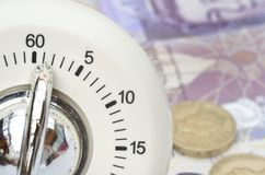 Timer with cash in  background Royalty Free Stock Photo