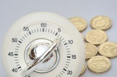 Timer in close up with group of pound  coins Stock Photos