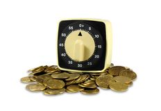 Timer and coins. Over white background isolated. Time and money concept Stock Photos