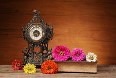 Timer, flowers and books Royalty Free Stock Photography
