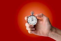 Timer-Griff in der Hand, Knopf gedrückt Lizenzfreies Stockfoto