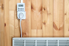 Timer operated electric con heater closeup Stock Photo