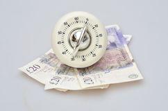 Timer over banknotes Royalty Free Stock Photos