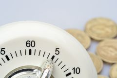 Timer with pound coins. White minute Timer with pound coins Royalty Free Stock Photography