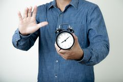 Times concept. Man hold alarm clock in his hand. Morning time to work royalty free stock image