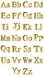 Times New Roman gold alphabet. 3D Times New Roman gold alphabet with shadows in a white background Stock Photography