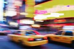 Times Square. Blurred photo of taki cabs driving through Times Square Royalty Free Stock Photography