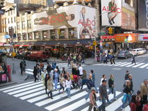 Times Square. In New York City with pedestrians and vendors along with the traffic is a very popular destination for tourist and a busy place for shoppers royalty free stock photography