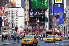 Times Square. With pedestrians, busy traffic and yellow taxi, is a symbol of New York and the United States, Photo taken on: April 30, 2012 in Manhattan, New royalty free stock photography