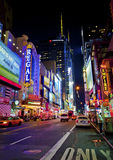 Times Square. NEW YORK CITY - JUNE 3: Times Square , is a busy tourist intersection of neon art and commerce and is an iconic street of New York City and America royalty free stock images