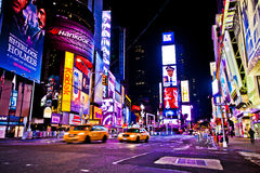 Times Square. NEW YORK CITY - DEC 28: Times Square ,is a busy tourist intersection of neon art and commerce and is an iconic street of New York City and America royalty free stock images