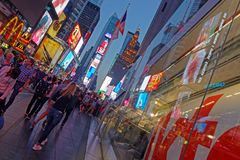 Times Square activities at dusk. NEW YORK CITY, USA, September 10, 2017 : Times square at night. Times Square is a major commercial intersection, tourist Stock Photography