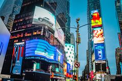 Times Square advertising billboards in bright lights at West 44th Street, Manhattan. Royalty Free Stock Photo