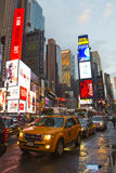 Times Square with animated LED signs and yellow cabs, Manhattan, New York City. Stock Image