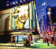 Times Square Area Street Corner at Night. NYC, New York - March, 2012 - Evening Photo of a corner at 52nd Street and Broadway just above the Times Square area of Royalty Free Stock Photography