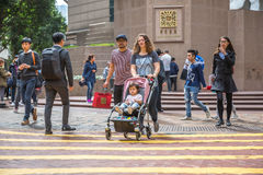 Times Square asian family. Hong Kong, China - December 6, 2016: typical asian mixed race family, crossing the Times Square intersection, largest shopping mall in Stock Images