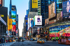 Times Square ,is a busy tourist intersection of neon art and com Stock Image